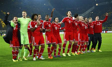 Bayern Munich's players celebrate victory against Borussia Dortmund during their German first division Bundesliga soccer match in Dortmund