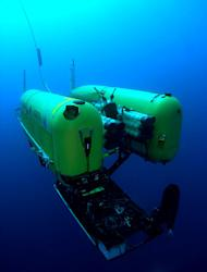 Underwater Nereus robot investigates hydrothermal vents along Earth's deepest mid-ocean ridge in the Cayman Trough. This unique vehicle can operate either as an autonomous, free-swimming robot for wide-area surveys, or as a tethered vehicle for