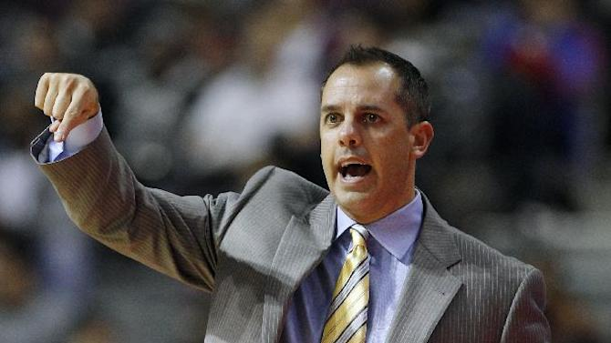Indiana Pacers coach Frank Vogel motions to his team during the first half of an NBA basketball game against the Detroit Pistons Tuesday, Nov. 5, 2013, in Auburn Hills, Mich. The Pacers defeated the Pistons 99-91
