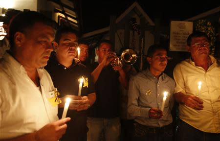 Residents pay homage in front of the house of Colombian Nobel Prize laureate Garcia Marquez in Aracataca