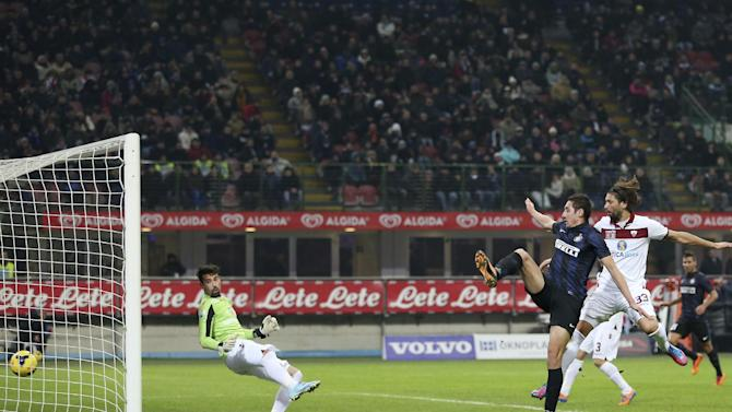 Inter Milan forward Ishak Belfodil, second from right, of Algeria, scores a goal during the Italian Cup soccer match between Inter Milan and Trapani at the San Siro stadium in Milan, Italy, Wednesday, Dec. 4, 2013