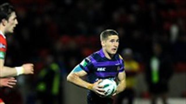 Rugby League - Tomkins treble hands Wigan the win