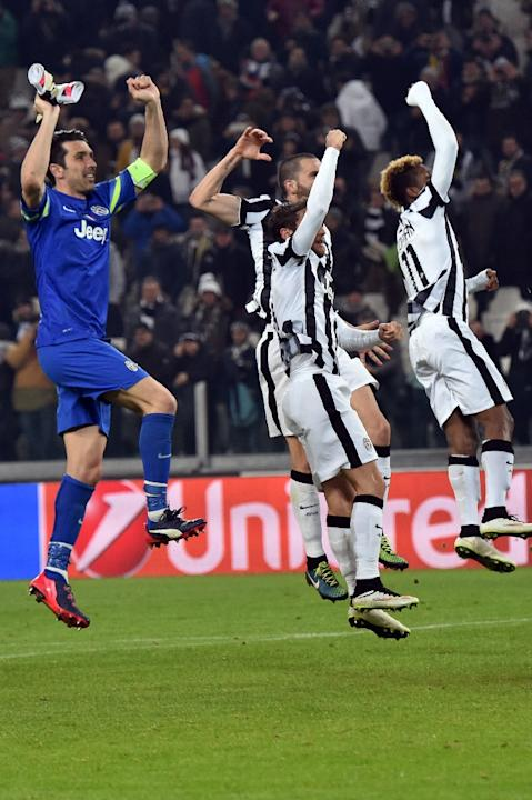 Juventus' players celebrate after defeating Borussia Dortmund in their Champions League round 16 first leg match in Turin on February 24, 2015