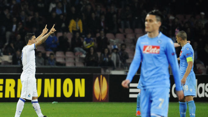 Porto's Fernando, left, celebrates at the end of an Europa League, round of 16 return-leg soccer match against Napoli at the Naples San Paolo stadium, Italy, Thursday, March 20, 2014