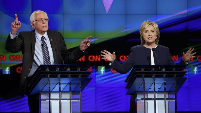 Democratic presidential candidates U.S. Senator Bernie Sanders and former Secretary of State Hillary Clinton debate during the first official Democratic candidates debate of the 2016 presidential campaign in Las Vegas