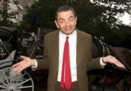 "Comedian Rowan Atkinson in character as ""Mr. Bean"" poses with horse and buggy at in New York to promote a new film in 2007. Mr Bean fans in Indonesia have been warned to beware of a locally made spoof horror film called ""Mr. Bean Possessed by D.P."" that stars an unknown actor with a resemblance to the popular character"