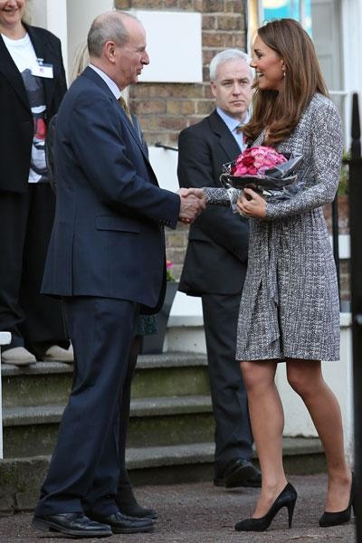 A Caribbean 'babymoon' sure did the trick. Kate Middleton was glowing at her first official public appearance since her vacation with husband Prince William. The tanned Duchess showed off a burgeoning baby bump Tuesday morning while visiting Hope House in London, a treatment centre run by the charity Action on Addiction. (Photo by Neil Mockford/FilmMagic)