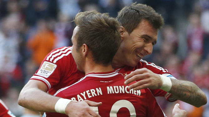 Bayern's Mario Mandzukic of Croatia, background, celebrates after with team mate Mario Goetze after scoring his side's third goal during the German first division Bundesliga soccer match between FC Bayern Munich and FSV Mainz 05, in Munich, southern Germany, Saturday, Oct. 19, 2013