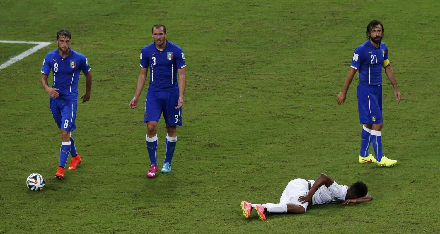 England's Sturridge lies on the pitch after sustaining an injury during their 2014 World Cup Group D soccer match against Italy at the Amazonia...