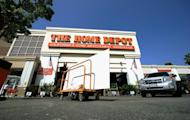 A customer pushes a cart with supplies at the Home Depot store on August 16, 2011 in the Hollywood, California. Canadian smartphone maker BlackBerry was handed a crushing setback for its glitzy new handsets when its major customer Home Depot confirmed on Tuesday it was switching to Apple's iPhones