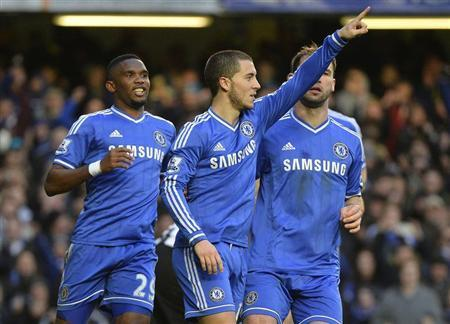 Chelsea's Hazard celebrates scoring his third goal against Newcastle United during their English Premier League soccer match in London