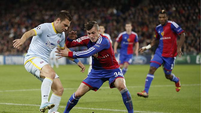 Basel's Taulant Xhaka, right, fights for the ball with Steaua's Adrian Popa during a Champions League group E group stage soccer match between Switzerland's FC Basel 1893 and Romania's FC Steaua Bucharest at the St. Jakob-Park stadium in Basel, Switzerland, Wednesday, Nov. 6, 2013