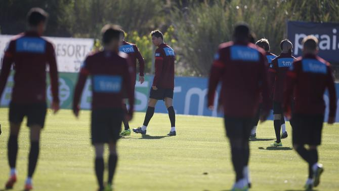 Portugal's Ronaldo and his teammates arrive for a training session in Obidos