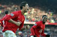 Cristiano Ronaldo (L) celebrates with former Manchester United teammate Patrice Evra in December 23, 2007. Evra has told Ronaldo to come home to Old Trafford if he doesn't feel loved at Real Madrid