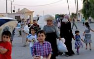 Syrians flee the town of Aazaz, near the northern restive Syrian city of Aleppo, following an air strike on the town