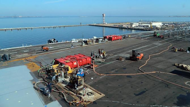 The deck of the aircraft carrier the USS Dwight D. Eisenhower is resurfaced as it is docked in Norfolk, Va., for repairs and maintenance, on Jan. 29, 2013. U.S. officials say that budget strains will force the Pentagon to cut its aircraft carrier presence in the Persian Gulf area from two carriers to one. The Eisenhower was in the Gulf but was brought home in December for maintenance. It will return later this month, but plans for the USS Harry S. Truman to deploy to the Gulf this week have been canceled. (AP Photo/Lolita Baldor)