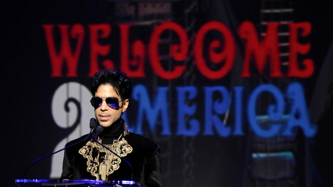 """FILE - In this Oct. 14, 2010 file photo, musician Prince holds a news conference at The Apollo Theater announcing his """"Welcome 2 America"""" tour in New York. Prince turns off the lights at South by Southwest on Saturday night, Match 16, 2013, with an unexpected and intimate showcase that ranks among the biggest surprises in years at the star-studded music festival and conference.  (AP Photo/Peter Kramer, File)"""