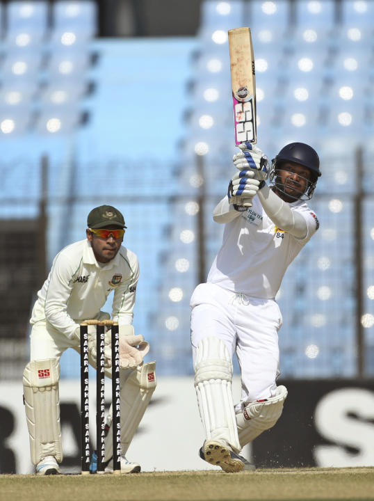 Sri Lanka's Kumar Sangakkara plays a shot on the first day of the second test cricket match against Bangladesh in Chittagong, Bangladesh, Tuesday, Feb. 4, 2014. Sangakkara's 34th century steered S