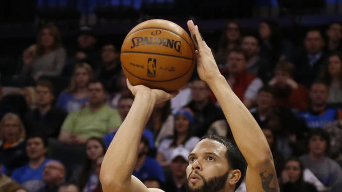 Brooklyn Nets guard Deron Williams (8) shoots undefended in the second quarter of an NBA basketball game against the Oklahoma City Thunder in Oklahoma City, Thursday, Jan. 2, 2014. Brooklyn won 95-93