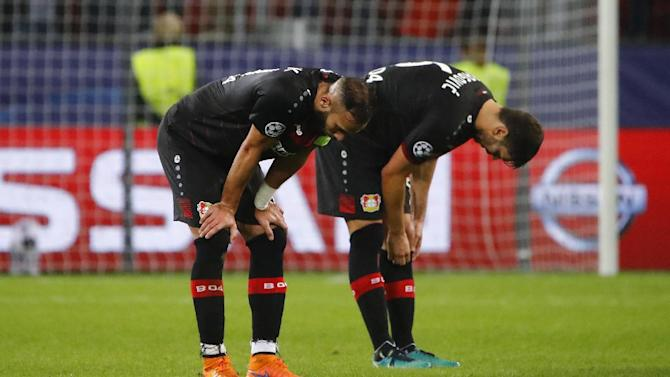 Bayer Leverkusen's Aleksander Dragovic and Omer Toprak look dejected after the match
