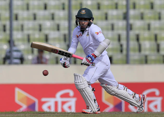 Bangladesh's captain Mushfiqur Rahim plays a shot during the first day of their second cricket test match against South Africa in Dhaka, Bangladesh, Thursday, July 30, 2015. (AP Photo/A.M. Ahad)