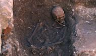 An undated picture released on February 4, 2013 by the University of Leicester shows the skeleton of king Richard III found at the Greyfriars Church excavation site in the city of Leicester, central England