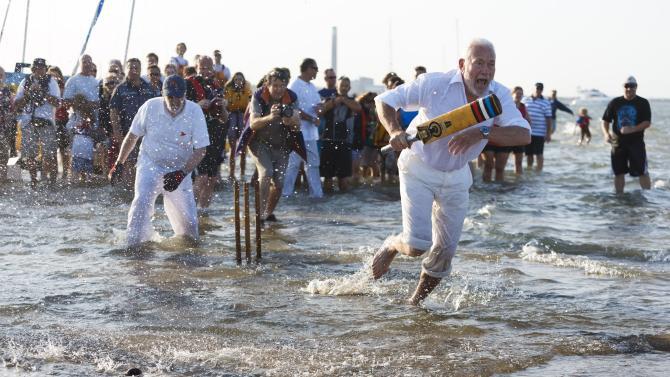 Annual Bramble Bank cricket match in the sea