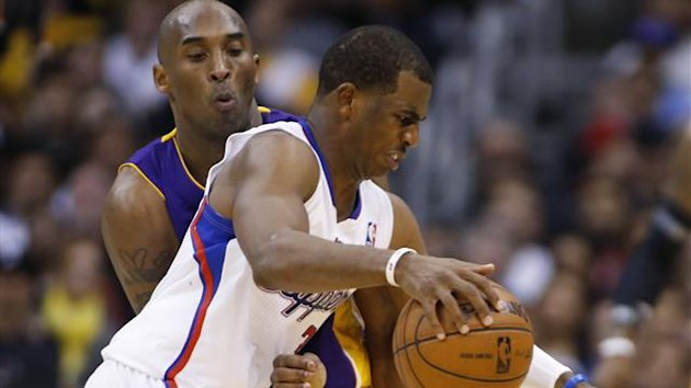 Los Angeles Clippers' Chris Paul (R) dribbles the ball as Los Angeles Lakers' Kobe Bryant (L) defends