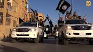 A video screen grab released on July 1, 2014 allegedly shows Islamic State (IS) militants parading on a street in the northern rebel-held Syrian city of Raqa