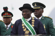 Nigerian President Goodluck Jonathan, center, inspects a guard of honor during his inauguration ceremony at the main parade ground in Nigeria's capital of Abuja, Sunday, May 29, 2011. Jonathan was sworn in Sunday for a full four-year term as president of Nigeria and is now faced with the challenge of uniting a country that saw deadly postelection violence despite what observers called the fairest vote in over a decade.