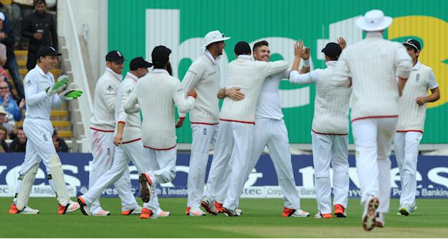 England's James Anderson, centre, is congratulated by teammates after bowling Australia's Peter Nevill for 2 runs during day one of the third Ashes Test cricket match, at Edgbaston, Birmingham, Englan
