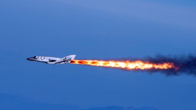"This photo provided by Virgin Galactic shows Virgin Galactic's SpaceShipTwo under rocket power, its first ever since the program began in 2005. The spacecraft was dropped from its ""mothership,"" WhiteKnightTwo, over Mojave, Calif., on Monday, April 29, 2013. The spaceship, bankrolled by British tycoon Sir Richard Branson, made its first powered flight in a test that moves Virgin Galactic toward its goal of flying into space later this year. While SpaceShipTwo did not break out of the atmosphere during the test flight, it marked a significant milestone for Virgin Galactic, which intends to take passengers on suborbital joyrides. (AP Photo/Virgin Galactic, Mark Greenberg)"