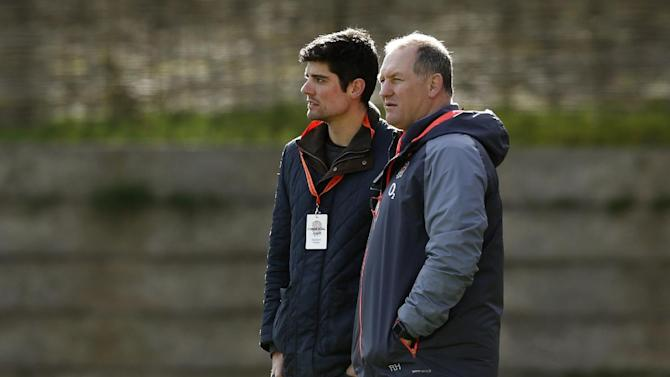 Former England rugby player Richard Hill (R) and England cricketer Alastair Cook watch training