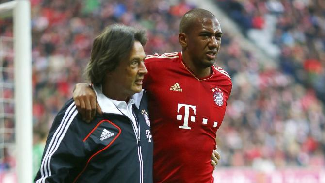 Bayern Munich's team doctor Hans-Wilhelm Mueller-Wohlfahrt treats Jerome Boateng during their German Bundesliga first division soccer match against Eintracht Frankfurt in Munich in this November 10, 2012 file picture