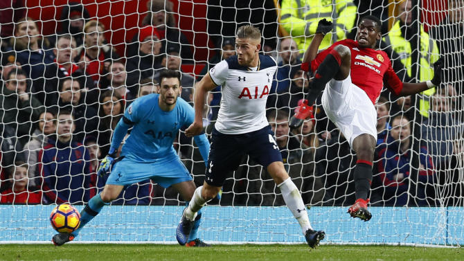 Manchester United's Paul Pogba in action with Tottenham's Toby Alderweireld