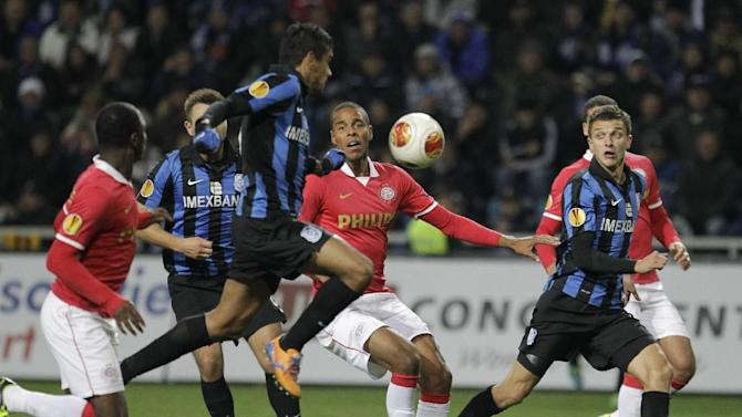Netherlands PSV's Mathias Jrgensen,center, challenges for the ball against Leo Matos,center left, of  FC Chornomorets  during a Europa League Group B soccer match between FC Chornomorets and  PSV Eindhoven at the Chornomorets  stadium in Odessa , Ukraine, Thursday, Oct. 3, 2013