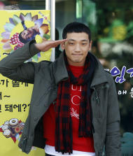 South Korean pop singer Rain gives a military salute to his fans before he enters the army to serve in front of an army training center in Uijeongbu, north of of Seoul, South Korea, Tuesday, Oct. 11, 2011. (AP Photo/ Lee Jin-man)