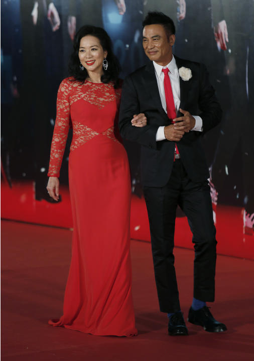 Former Miss Hong Kong Olivia Cheng, left and Hong Kong actor Simon Yam pose on the red carpet of the 33rd Hong Kong Film Awards in Hong Kong Sunday, April 13, 2014.(AP Photo/Vincent Yu)