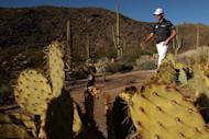 Webb Simpson walks between holes during the quarter-final of the WGC Match Play Championship on February 23, 2013. Hunter Mahan came out on top in a tense duel with Simpson