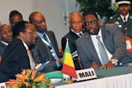 Dioncounda Traore (left), the interim president of Mali speaks with Senegalese President Macky Sall during an emergency ECOWAS summit held to discuss violence and unrest in Mali and Guinea Bissau, on April 26, 2012, in Abidjan