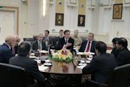 Britain's Prime Minister David Cameron (C), talks with Pakistani Prime Minister Raja Pervaiz Ashraf (R), and Afghan President Hamid Karzai (L) during a meeting at the presidential palace in KabulAfghan efforts to negotiate with the Taliban need Islamabad's help if they are to be successful, the leaders of Afghanistan, Britain and Pakistan emphasised