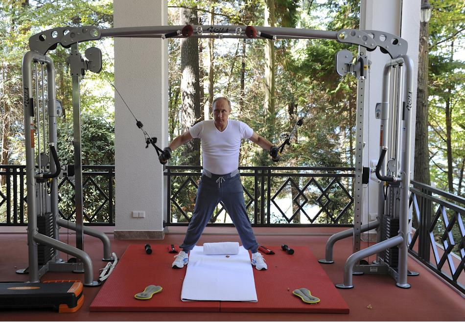 Russian President Putin exercises in a gym at the Bocharov Ruchei state residence in Sochi
