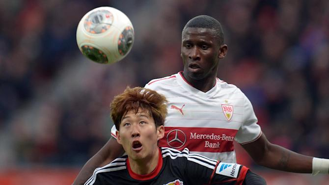 Leverkusen's Son Heung-min, front,   and Stuttgart's  Antonio Ruediger  challenge for the ball during the German Bundesliga soccer match between Bayer Leverkusen and VfB Stuttgart in Leverkusen, western Germany, Saturday Feb. 1, 2014