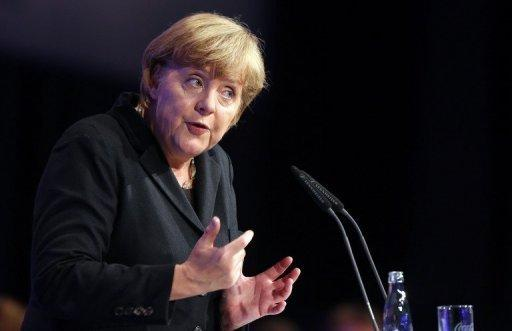"""German chancellor Angela Merkel speaks on October 5 at a Youth Union convention in Rostock. Merkel will travel to Greece on Tuesday with a message of support for the """"ambitious"""" cuts already in place in Athens but also encouragement to maintain the efforts, her spokesman said."""