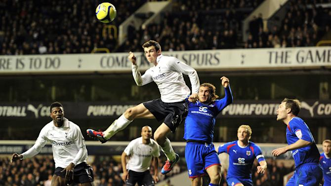 "Tottenham Hotspur's Welsh defender Gareth Bale attempts a header towards goal during their FA Cup fifth round replay football match against Stevenage at White Hart Lane, London, England, on March 7, 2012. AFP PHOTO/GLYN KIRK  RESTRICTED TO EDITORIAL USE. No use with unauthorized audio, video, data, fixture lists, club/league logos or ""live"" services. Online in-match use limited to 45 images, no video emulation. No use in betting, games or single club/league/player publications. (Photo credit should read GLYN KIRK/AFP/Getty Images)"