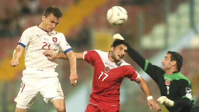 Czech Republic Tom Hbschman, left, scores a goal during the World Cup Group B qualifying soccer match between Malta and Czech Republic at National Stadium Ta' Qali in Valletta, Malta, Friday, Oct. 11, 2013
