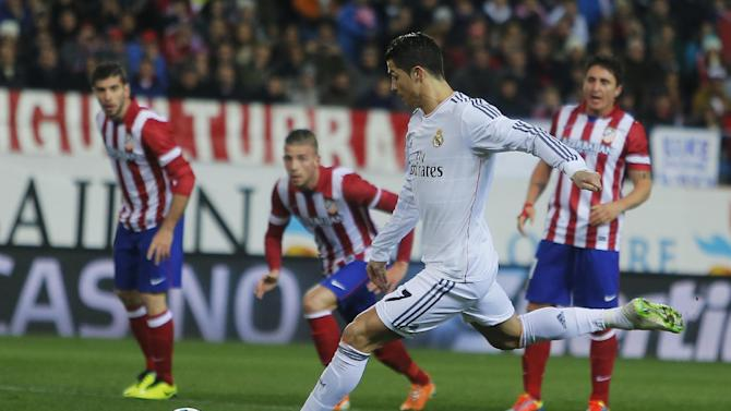 Real's Cristiano Ronaldo scores his goal during a semi final, 2nd leg, Copa del Rey soccer match between Atletico de Madrid and Real Madrid at the Vicente Calderon stadium in Madrid, Spain, Tuesday, Feb. 11, 2014