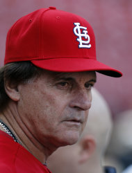 St. Louis Cardinals manager Tony La Russa, left, visits with members of the media, Monday, Oct. 3, 2011, in St. Louis. The Cardinals are scheduled to play the Philadelphia Phillies in Game 3 of baseball's National League division series playoffs on Tuesday. (AP Photo/Jeff Roberson)