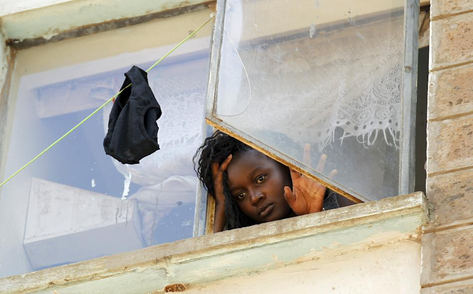 A student at the University of Nairobi looks down from the window at the Kimberly ladies hostels at the Kikuyu campus