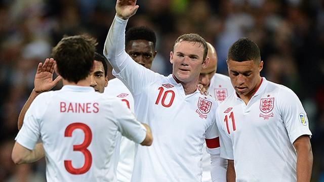 Neville impressed by 'lean and hungry' Rooney